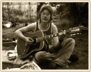 Young Norbert Krueler playing guitar